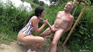 Provocative slut drops on her knees to suck an older man's dick